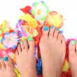 Women feets and flowers (pedicure tbackground) — Stock Photo #73227219