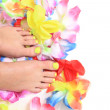 Women feets and flowers (pedicure tbackground) — Stock Photo #73227369