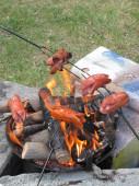 Bratwurst preparing on the fire — Stock Photo