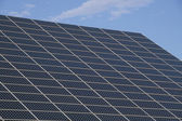 Solar panels for energy saving with blue sky behind — Stock Photo