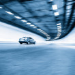 Interior of an urban tunnel with car,motion blur — Stock Photo #55029005