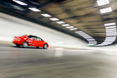Interior of an urban tunnel with car,motion blur — Photo