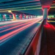 Light traces on traffic junctions at night — Stock Photo #55030015