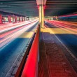 Light traces on traffic junctions at night — Stock Photo #55030091