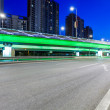Light traces on traffic junctions at night — Stock Photo #55031279