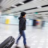 Passenger in the Beijing airport,motion blur — Stock Photo
