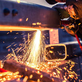 Worker cutting steel pipe using metal torch and install roadside — Stok fotoğraf