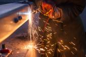 Worker cutting steel pipe using metal torch and install roadside — Stockfoto