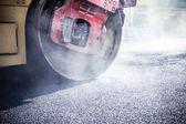 Road roller repairing asphalt pavement — Stock Photo