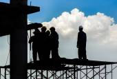 Silhouette of construction worker — Stock Photo
