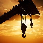 The crane hook silhouette — Stock Photo