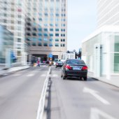 Car driving in the business district,motion blur — Stock Photo
