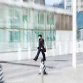 People walking in the business district,motion blur — Stock Photo