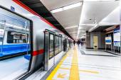Moving train in subway station — Stock Photo