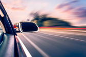 Ar on the road whit motion blur background — Stock Photo