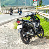 Motorcycle parked on the roadside — Stock Photo
