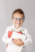 Young boy with books preparing to school — Stock Photo