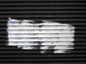 Spot of white paint on the old roller blinds. — Stock Photo