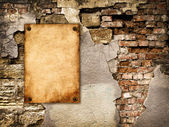 The old paper attached to the cracked wall   — Stock Photo