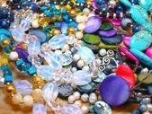 Scattering beads of semiprecious stones — Stock Photo