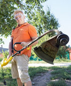 Man with a lawn mower — Stock Photo
