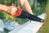 Male worker sawing a board — Stock Photo