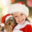 Little girl and dog at Christmas — Stock Photo #56247213