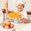 Happy little baker with tasty pancakes — Stock Photo #63769095