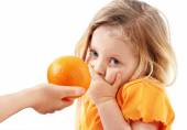 The whimsical child doesn't want to eat orange — Stock Photo