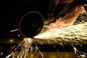 Metal grinding on steel pipe — Stock Photo