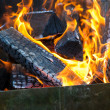 Flames and smoke from burning wood — Stock Photo #56560405