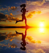 Running girl at sunset silhouette — Stock Photo