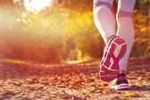 Fitness Girl running at sunset — Stock Photo
