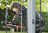 Burglar breaking in a house — Stock Photo