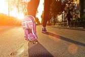 Fitness Girl running at sunset — Stockfoto