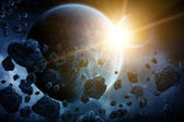 Asteroids over planet earth — Stock Photo