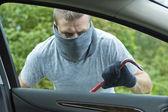 Thief stealing a car — Stock Photo