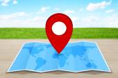 Pin map icon on a blue map — Stock Photo