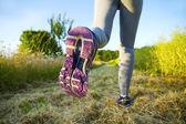 Woman running in a field — Foto Stock
