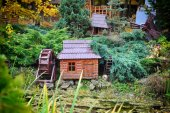 Little house model and mill on nature — Stock Photo
