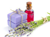 Aroma oil and handmade soap with lavender flowers — Stock Photo