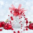 Christmas red and silver balls on snow on festive background — Stock Photo #58994741