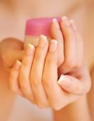 Beautiful woman hands with cream — Stock Photo