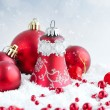 Christmas red balls on snow on festive background — Stock Photo #59801381