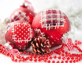 Closeup of red Christmas balls on festive background — Stock Photo