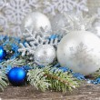 Christmas blue and silver decorations with branches of spruce — Stock Photo #60885671