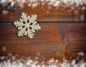 Gold decoration snowflake on a wooden background — Stock Photo