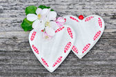 Spring Blossom and hearts over wooden background — Stock Photo