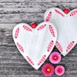 Two hearts with flowers on a wooden background old — Stock Photo #63488793