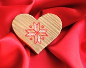 Wooden Heart on red satin background — Stock Photo